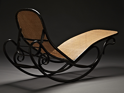 black and rattan rocking chaise