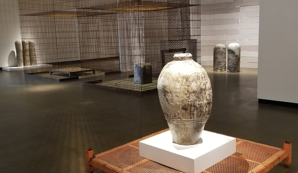 Large vessel foreground, installation view from within gallery